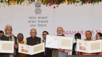 Prime Minister Narendra Modi accompanied by UP Governor Ram Naik, Chief Minister Yogi Adityanath and Union MoS Communications Manoj Sinha, releases the commemorative postal stamp on Maharaja Suheldev at the foundation stone laying ceremony of Medical College in Ghazipur, Uttar Pradesh on 29 December, 2018.