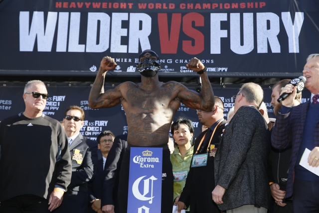WBC heavyweight titleholder boxer Deontay Wilder wears a mask during his official weigh-in ceremony Friday, Nov. 30, 2018, at Staples Center in Los Angeles, ahead of his bout against boxer Tyson Fury.