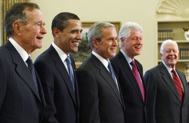 In this 2009 photo, President George W Bush <i>(center)</i> poses with President-elect Barack Obama (second left) and former presidents, George HW Bush (left), Bill Clinton <i>(second right)</i>, and Jimmy Carter <i>(right)</i>, in the Oval Office of the White House in Washington.