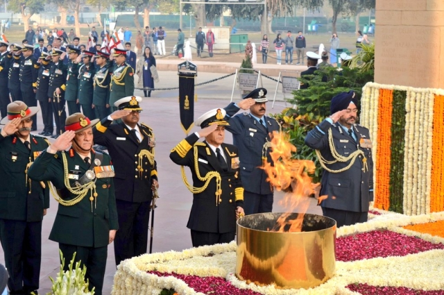 Chiefs of the Indian Army, The Indian AirForce and the Indian Navy pay homage at the Amar Jawan Jyoti, India Gate on the occasion of Navy Day.