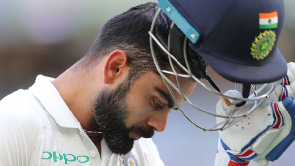 Virat Kohli walks off after being dismissed on Day 4 of India's second Test against Australia at Perth.