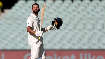 Cheteshwar Pujara's 123 guided India to 250 for nine on the opening day of their first Test against Australia.