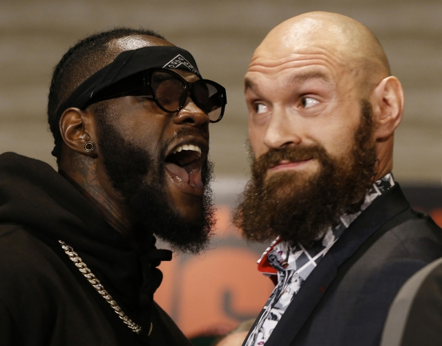 Boxers Deontay Wilder, left, and Tyson Fury exchange words as they face each other at a news conference in Los Angeles, Wednesday, Nov. 28, 2018. The pair are slated to fight Saturday night for Wilder's WBC heavyweight title.