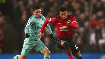 ManU midfielder Jesse Lingard, right, and Arsenal's Lucas Torreira, left, vie for the ball during the English Premier League soccer match between Manchester United and Arsenal.