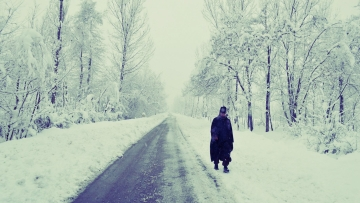 A Kashmiri man walks through a snow-covered road in Anantanag. Archival image used for representational purposes.