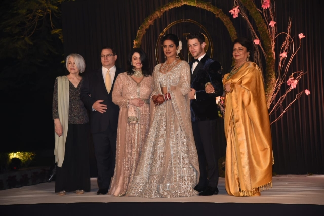 Priyanka & Nick pose for a picture with their parents.