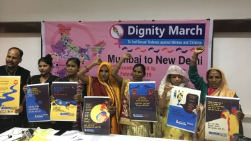 The convenor of Rashtriya Garima Abhiyan, along with sexual violence survivors, including Bhanwari Devi, at the press conference.