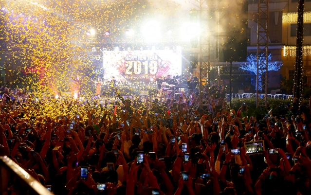 Confetti rains down on revellers at the Eastwood Shopping Mall as Filipinos welcome the New Year on 1 January 2019, in suburban Quezon city northeast of Manila, Philippines.