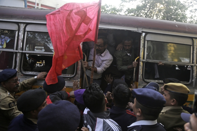 Trade union activists are detained during a demonstration on the first day of a two-day general strike called by various trade unions in Kolkata on Tuesday, 8 January.