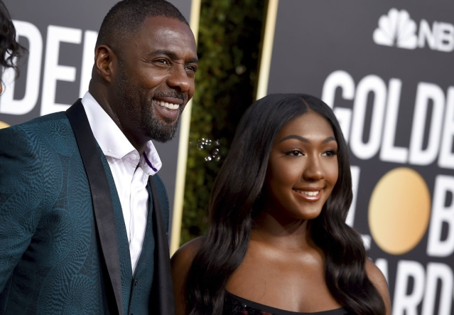 Idris Elba (left) and his daughter Isan.