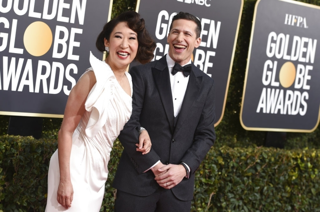 Hosts Sandra Oh (left) and Andy Samberg in the mood for some fun.