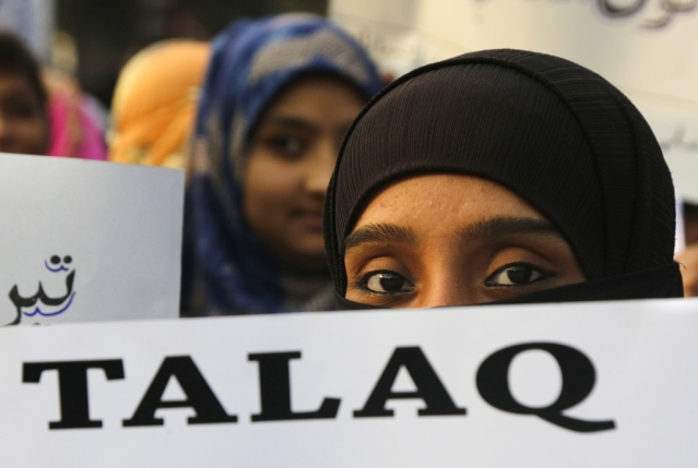 A Muslim woman holds a placard in Kolkata that reads 'Talaq', meaning 'divorce', during a protest against India's Parliament's move to approve a bill to implement the Supreme Court's ruling that found the Muslim practice of instant divorce was unconstitutional, on Thursday, 10 January, 2019.