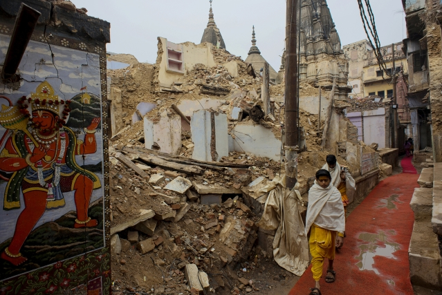 Two young Sanskrit scholars walk along an alley at the demolition site. Quite a few Sanskrit schools have been brought down for the corridor.