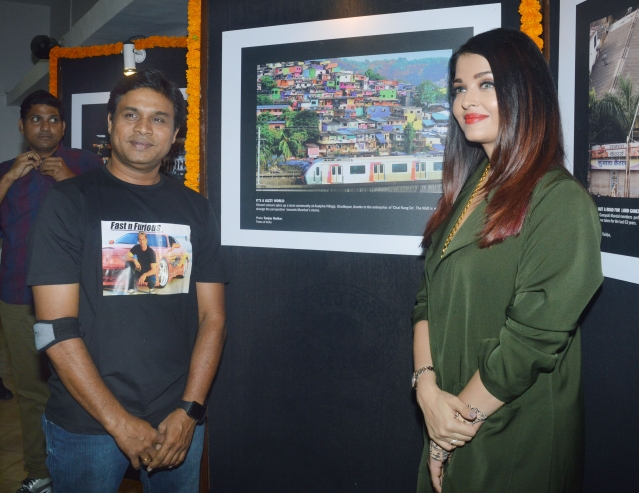 Aishwarya Rai posing for pictures at the exhibition.