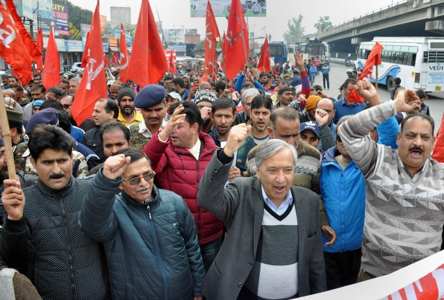 "CPI(M) Secretary MY Tarigami with Centre of Indian Trade Union (CITU) activists raise slogans during the 48-hour long nationwide general strike called by Central trade unions protesting against the ""anti-people"" policies of the Centre, in Jammu."