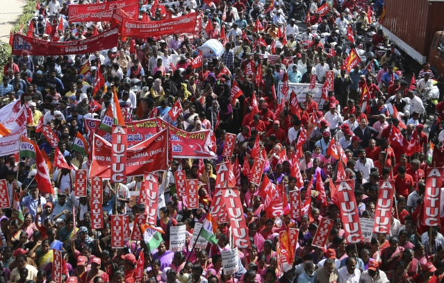 Indian trade union activists participate in a demonstration on the first day of a two-day long nationwide general strike called by various trade unions in Bengaluru, India.
