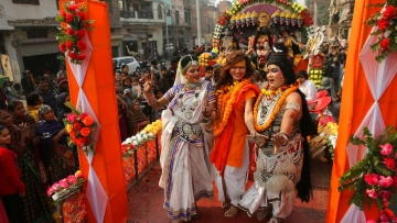 Artists perform with a member of Kinnar Akhara for transgenders, during a religious procession towards Sangam, the confluence of rivers Ganges, Yamuna and mythical Saraswati, as part of the Kumbh festival in Allahabad, on Sunday, 6 January, 2019.