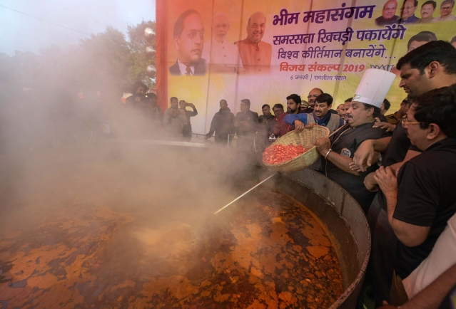 Delhi BJP Chief Manoj Tiwari and other leaders prepare Khichdi during Bhim Mahasamagam event at Ramlila Maidan.