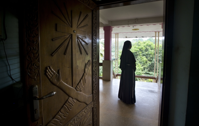 In this Saturday, 3 November, 2018, photo, a Catholic nun stands at the foyer of the St. Francis Mission Home in Kuravilangad.