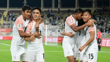 Indian captain Sunil Chhetri celebrates a goal against Thailand with his team-mates.