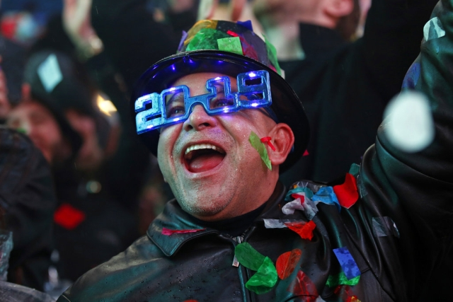 A reveler celebrates as confetti falls during a New Year's celebration in New York's Times Square on 1 January 2019.