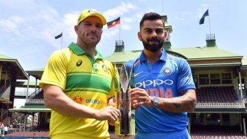 Captains Aaron Finch and Virat Kohli pose with the trophy ahead of India's three-match ODI series in Australia.
