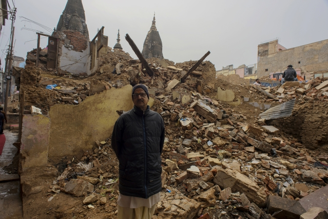 Shravan Kumar Goswami poses for a photograph at the place where his house had once stood.