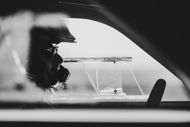 A participant is clicked through his car window as he prepares to launch himself into the tarmac.