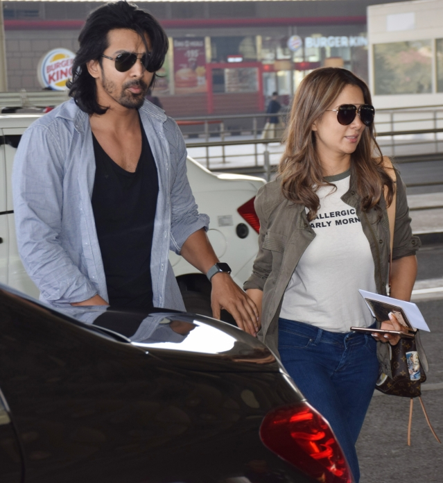 Lovebirds Harshvardhan Rane and Kim Sharma at the airport.