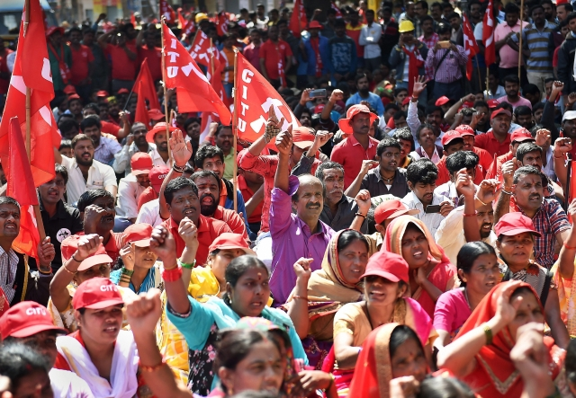 "Factory workers and members of Centre of Indian Trade Unions (CITU) shout slogans during the 48-hour long nationwide general strike called by Central trade unions protesting against the ""anti-people"" policies of the Centre, in Bengaluru on Tuesday, 8 January."