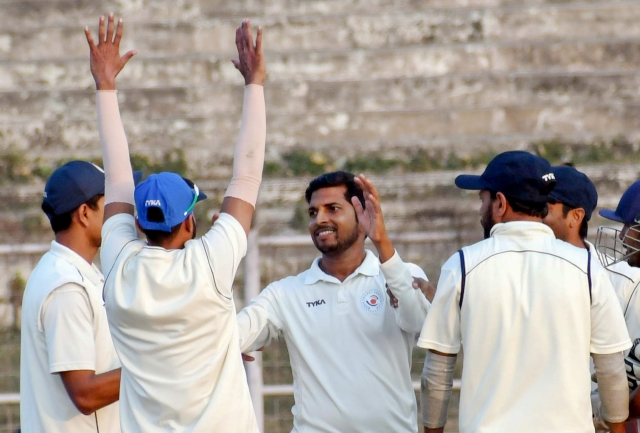 Bihar bowler Ashutosh Aman (C) celebrates with teammates during a Ranji Trophy cricket match.