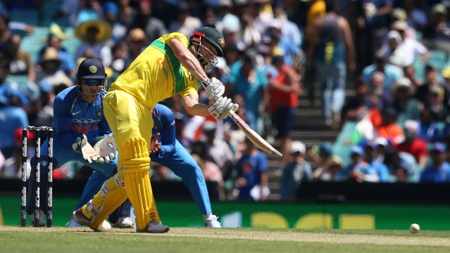 Australia's Shaun Marsh drives the ball against India during the 1st ODI in Sydney, on Saturday, Jan 12, 2019.