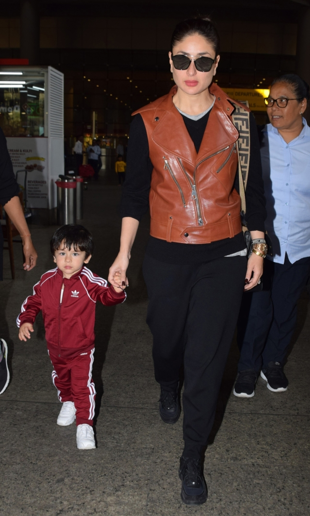 Mother and son up the airport fashion game.
