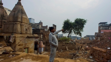 Prabhu Singh points towards his house that he refuses to part with unless he gets the amount he wants as compensation.