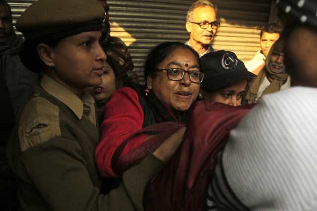Trade union activists are detained by police on the first day of a two-day general strike called by various trade unions in Kolkata on Tuesday, 8 January.