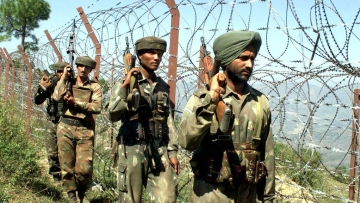 Indian army soldiers patrol near the fenced Line of Control in Jammu and Kashmir. Image used for representational purposes.