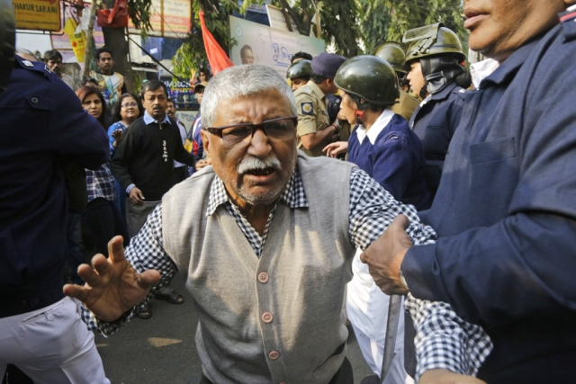 Policemen detain an elderly activist of the Communist Party of India-Marxist (CPI-M) during a rally on the second day of a two-day general strike called by various trade unions in Kolkata, on Wednesday, 9  January 2019. The strike had been called against the government's alleged anti-worker policies and unilateral labour reforms.