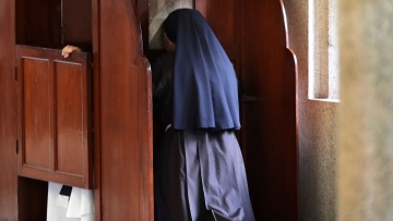 In this Sunday, 4 November , 2018, photo, a nun partakes in the sacrament of confession at the Immaculate Heart of Mary Cathedral in Kottayam.