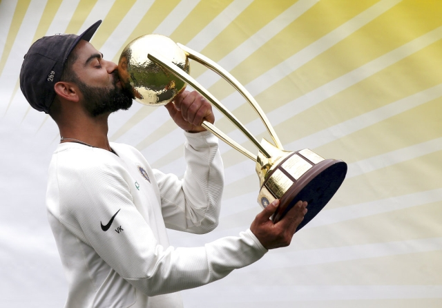 India cricket captain Virat Kohli kisses the trophy as he celebrates India's series win over Australia after play was called off on day 5 of their cricket test match in Sydney, on Monday, 7 January, 2019.