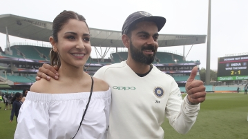 India's cricket captain Virat Kohli, right, walks with his wife, Anushka Sharma celebrates India's series win over Australia after play was called off on day 5 of their cricket test match in Sydney, Monday, Jan. 7, 2019.