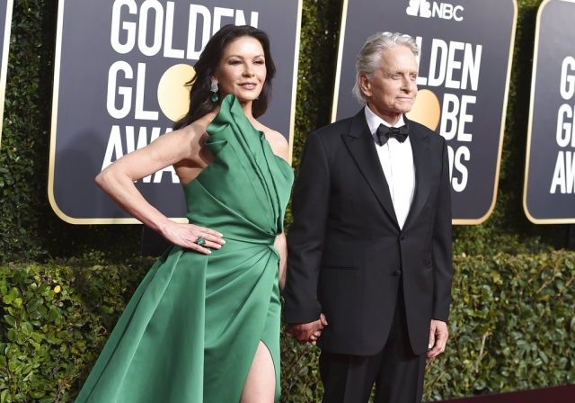 Catherine Zeta-Jones (left) and Michael Douglas arrive together for the award show.