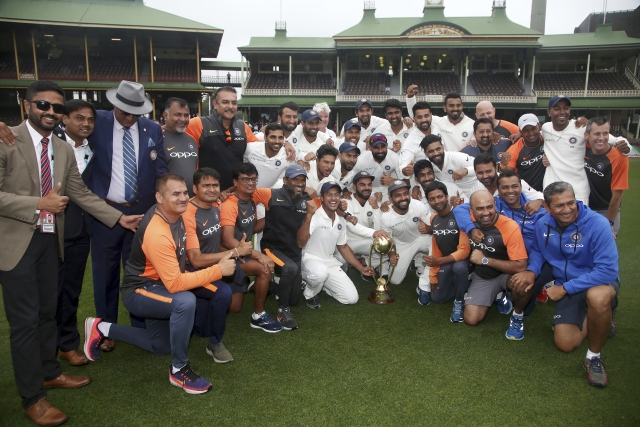 The Indian cricket team and support staff celebrate their series win over Australia after play was called off on day 5 of their cricket test match in Sydney, Monday, Jan. 7, 2019. The match is a draw and India wins the series 2-1.