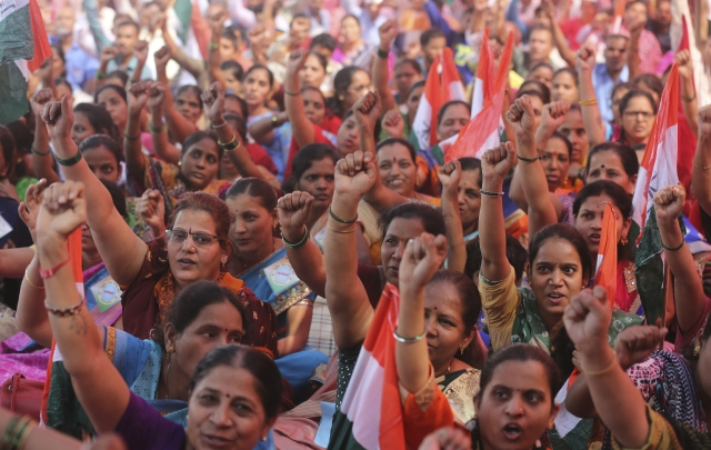 Trade union members raise slogans on the first day of a two-day general strike called by various trade unions in Mumbai, India.