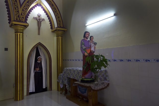 In this Sunday, 4 November, 2018, photo, a Catholic nun walks in the chapel of St. Francis Mission Home in Kuravilangad.