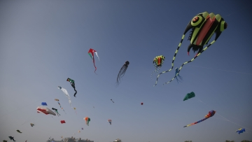Colourful kites can be seen in the sky at the Sabarmati Riverfront in Ahmedabad