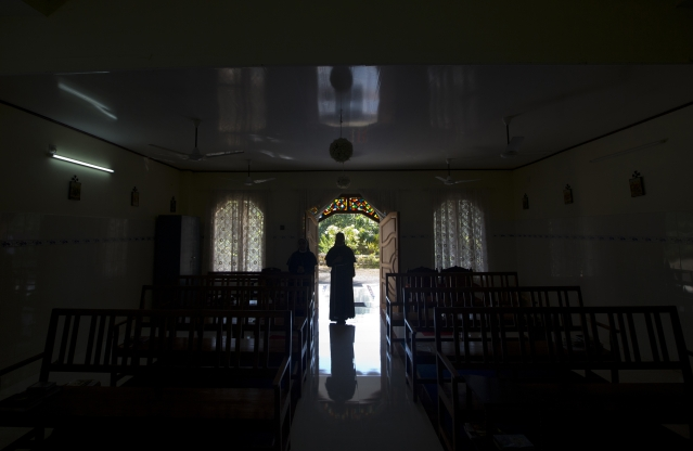 In this Sunday, 4 November, 2018, photo, a nun walks out of chapel of St. Francis Mission Home after offering prayers, in Kuravilangad.