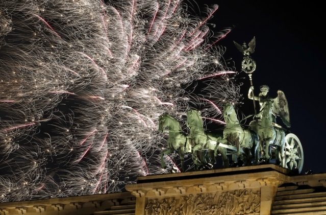 Fireworks light the sky above the Quadriga at the Brandenburg Gate shortly after midnight in Berlin, Germany on 1 January 2019. Hundred thousands of people celebrated New Year's Eve welcoming the new year 2019 in Germany's capital.