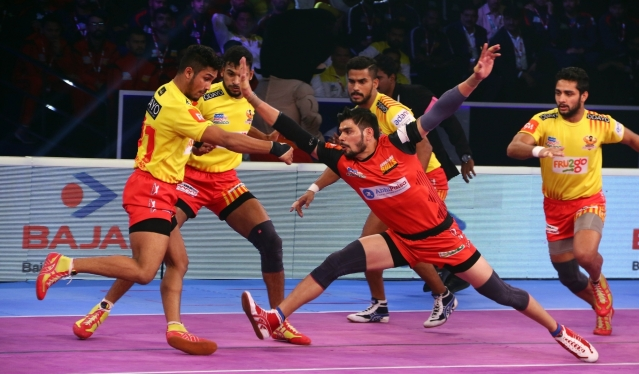 Players in action during a Pro Kabaddi League 2018 match between Bengaluru Bulls and Gujarat Fortunegiants at the Rajiv Gandhi Indoor Stadium in Kochi on Dec 31, 2018.