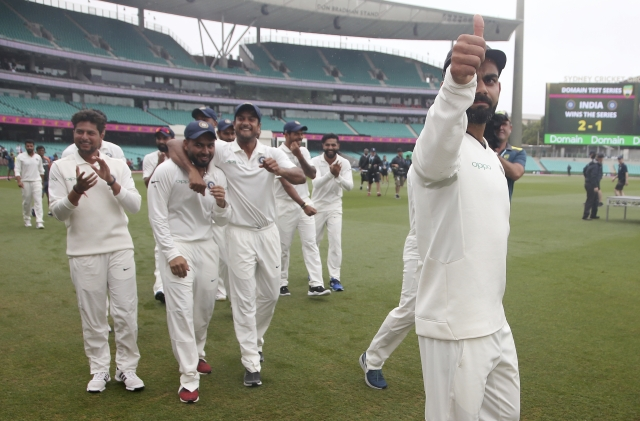 India's captain Virat Kohli, right, celebrates with teammates after India's series win when play was called off on day 5 of their cricket test match in Sydney, Monday, Jan. 7, 2019. The match is a draw and India wins the series 2-1.