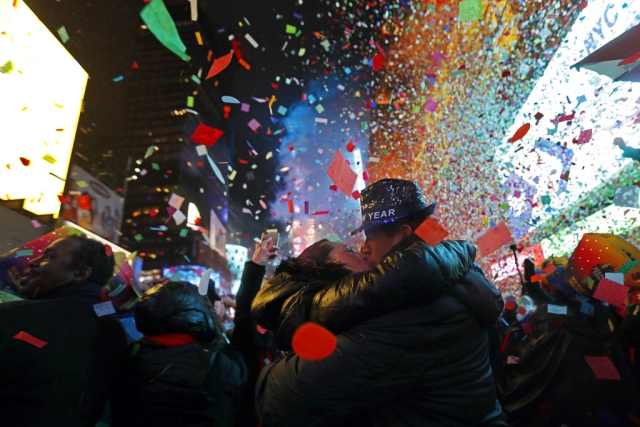 Joey and Claudia Flores, of California, kiss as confetti falls during a New Year's celebration in New York's Times Square on 1 January 2019.